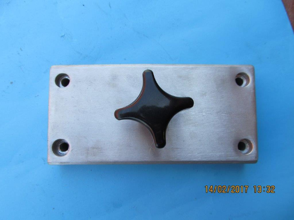 Supra-Jeba Sliding arm guide block with knob.